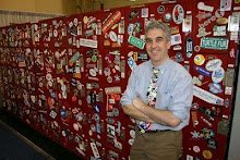 Jeff Nicholson in front of lockers covered with stickers