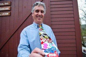 Jeff Nicholson, owner / marketing director for Websticker displays his sticker tie