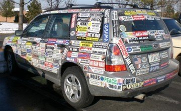 a car covered with bumperstickers